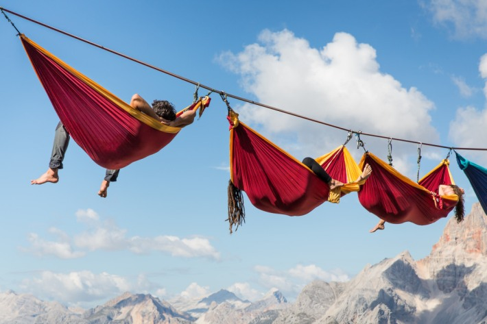 People relaxing in hammocks around 40 meters above the ground. This took part in an annual highline meeting in Monte Piana, in the Italian Dolomites last autumn. For some it might look like a nightmare to dangle so far above the ground but for some this was just the way to take a rest.