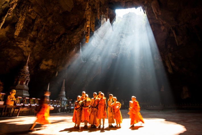 A group of young monks visiting Khao Luang cave in North Phetchaburi, Thailand.