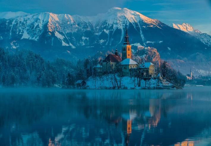A shot at the church in lake Bled at sunrise.